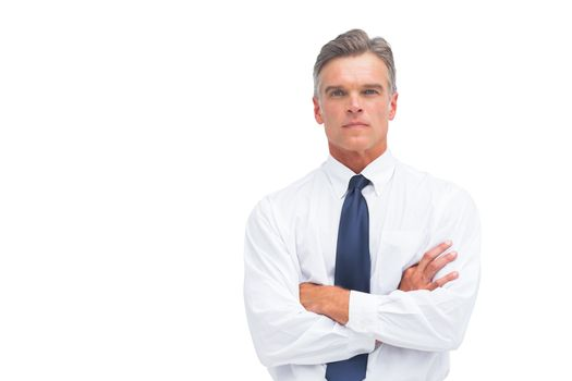 Stern businessman with crossed arms