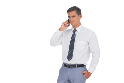 Unsmiling businessman on the phone