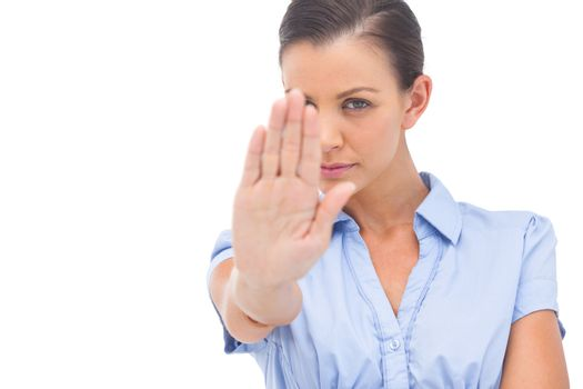 Businesswoman saying stop with hand