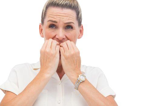 Anxious businessman biting nails