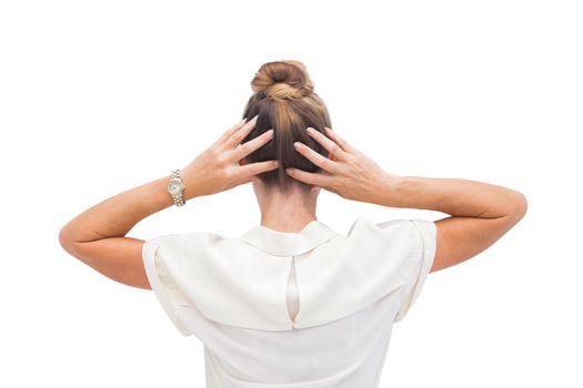 Businesswoman massaging her hair