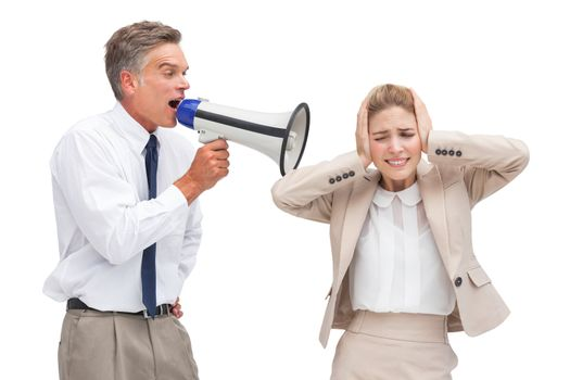 Businessman yelling at his coworker with megaphone