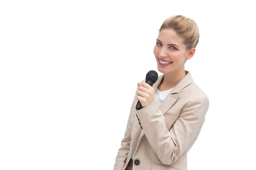 Well dressed woman with microphone