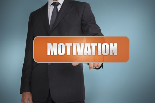Businessman selecting the word motivation