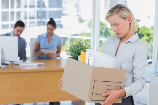 Businesswoman leaving office after being laid off
