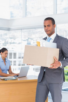 Upset businessman leaving the company