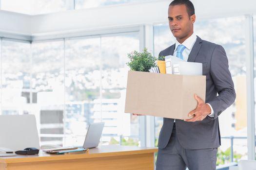 Sad businessman leaving his company