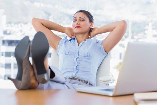 Attractive businesswoman having a nap