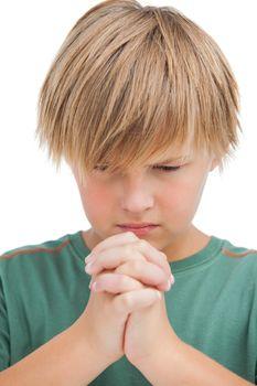 Little boy saying his prayers