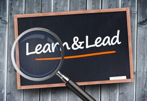 Learn and lead written on a blackboard