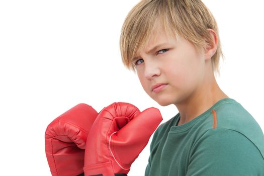 Furious boy with boxing gloves