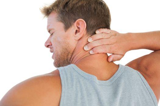 Handsome man having a neck ache