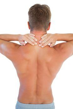 Topless man having a neck ache
