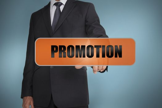Businessman touching the word promotion