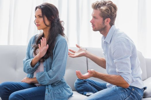 Woman gesturing while quarreling with her partner