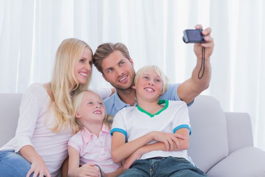Family taking pictures of themselves