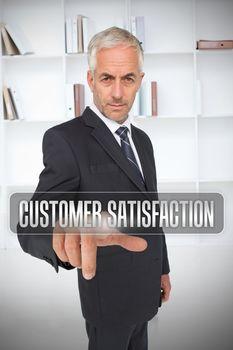 Businessman selecting the term customer satisfaction