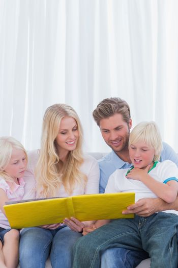 Cheerful family reading a story together