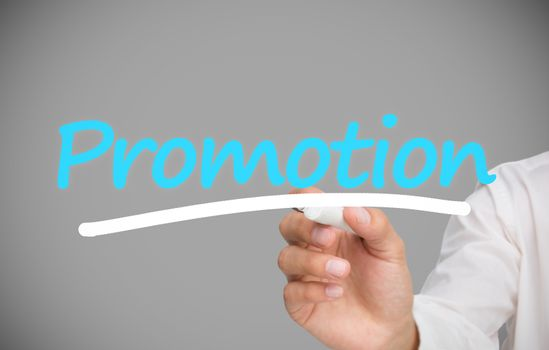Businessman writing promotion