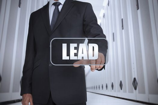 Businessman in a data center selecting label with lead