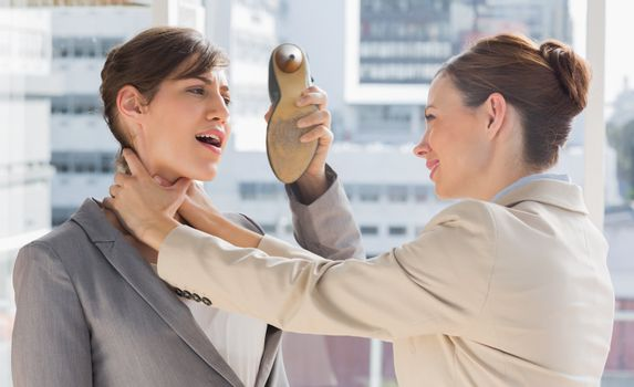 Businesswoman defending herself from her colleague strangling he