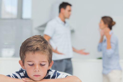 Sad boy while parents quarreling