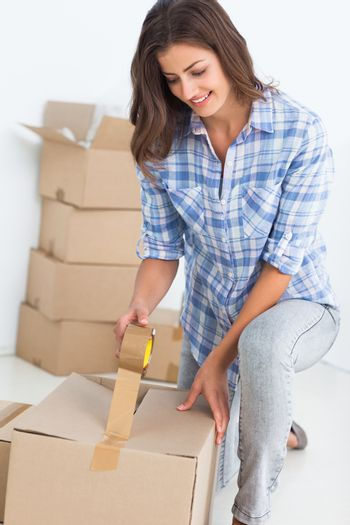 Woman wrapping a box