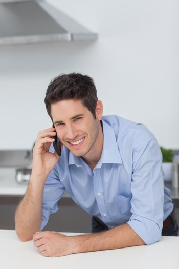 Man phoning in the kitchen