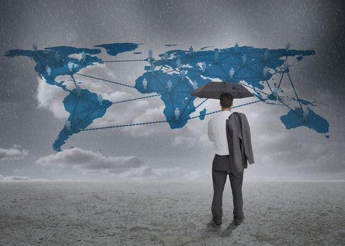 Thinking businessman viewing world map