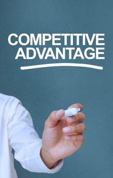 Businessman writing competitive advantage