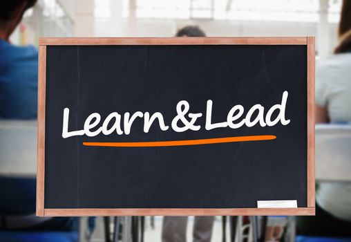 Learn and lead written on blackboard