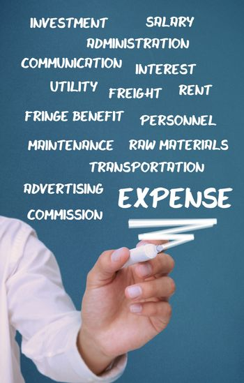Businessman writing expense terms with a marker