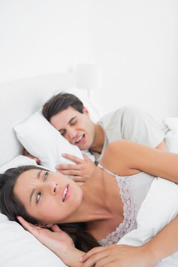 Woman annoyed that her partner snoring