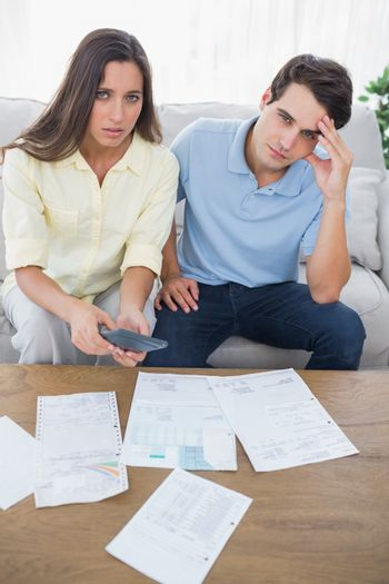 Concerned couple doing their accounts