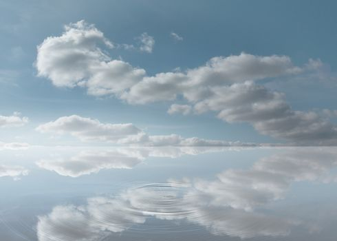 Reflection of the sky on a puddle