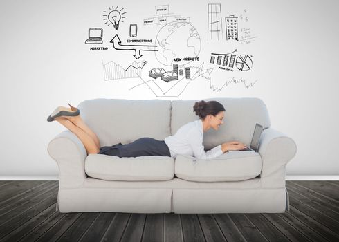 Cheerful businesswoman lying on couch