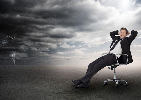 Businessman sitting in a swivel chair