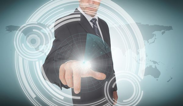 Businessman selecting a futuristic dial