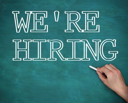 Hand writing we are hiring on green background