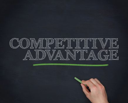 Hand underlining the word competitive advantage in green