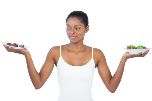 Woman deciding to eat healthily or not