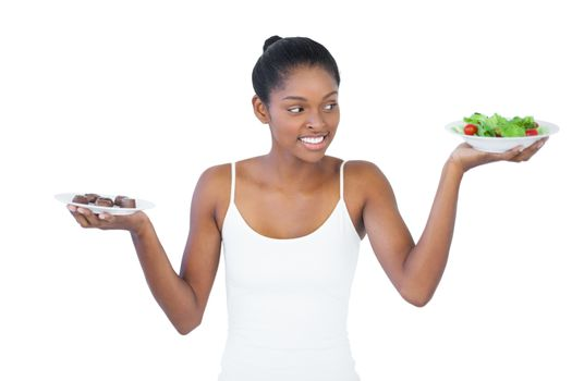 Cheerful woman deciding to eat healthily or not