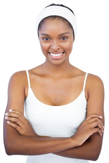 Smiling woman with headband crossing her arms