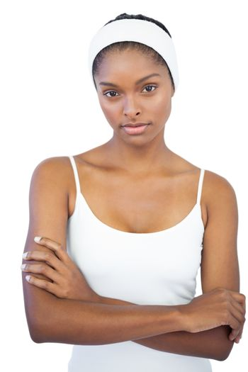 Woman with headband crossing her arms