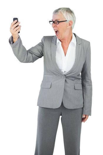 Furious businesswoman screaming during a call