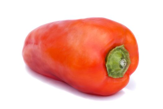 Large red pepper. Photographed close-up on a white background.