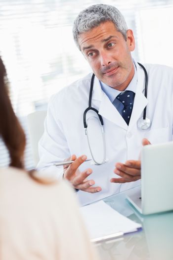 Doctor explaining a sickness to his patient