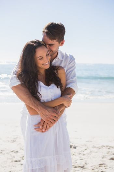 Affectionate couple cuddling