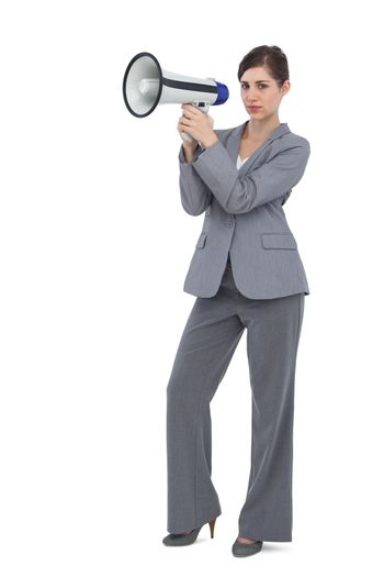 Serious businesswoman with loudspeaker
