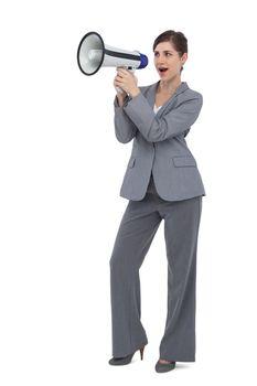 Businesswoman with loudspeaker